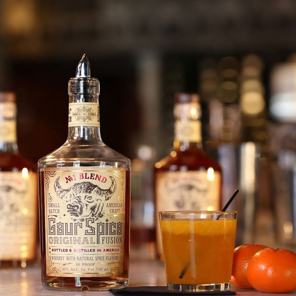 A handcrafted small batch American whiskey that fuses East and West cultural traditions, Gaur Spice Whiskey draws from ancient Indian practices of spice mixing